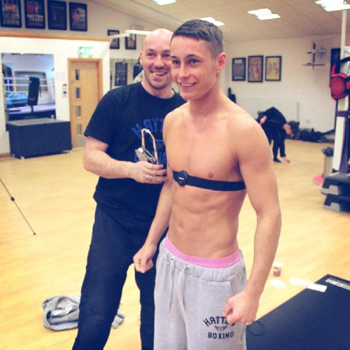 Ric Moylan measuring Ryan Burnett Body Composition.